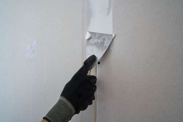 foundation crack repair company finishing drywall work